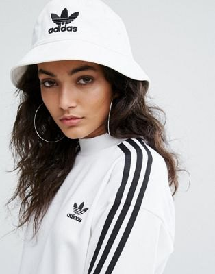 white bucket hat with sports jacket