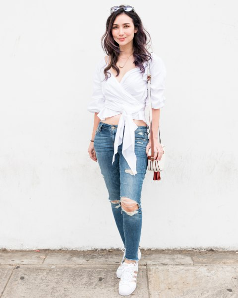 white cropped wrap blouse with ripped skinny jeans