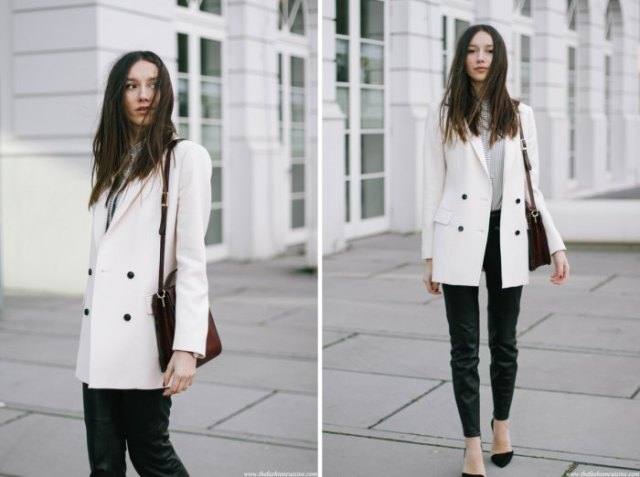 white double breasted long blazer with grey sweater black jeans