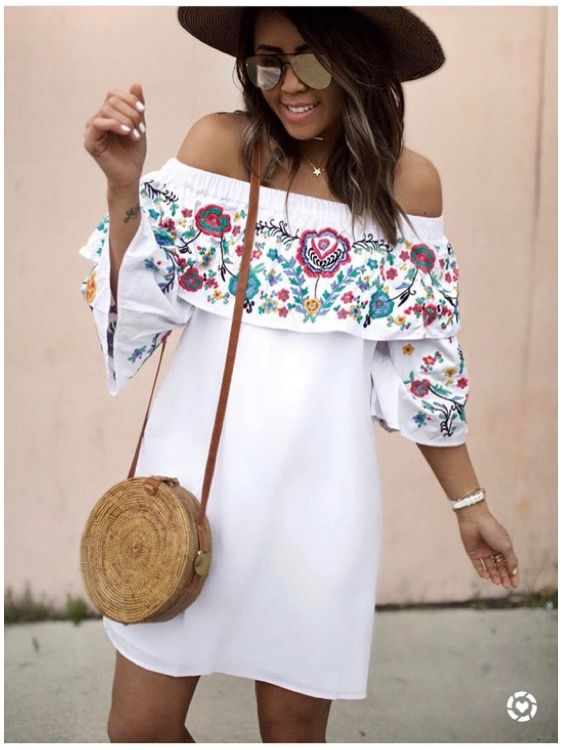 white embroidered dress off the shouler