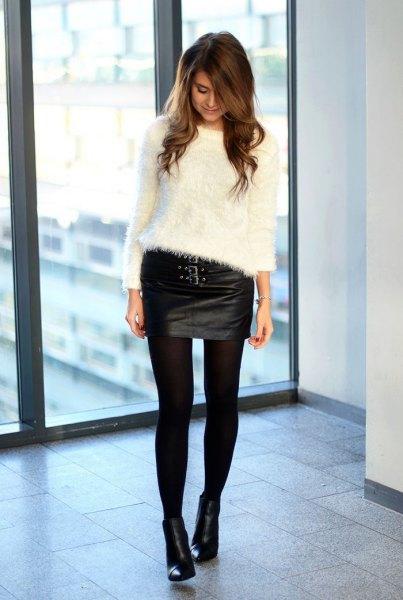 white fuzzy sweater black leather mini skirt