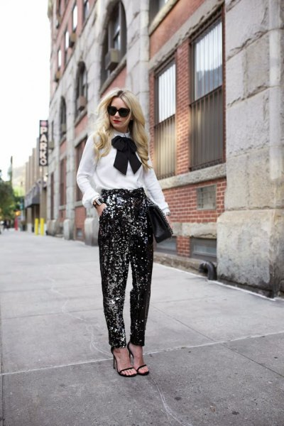 white ribbon bow blouse with black glitter wide leg pants