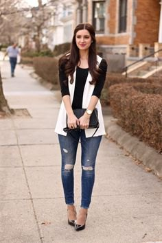 white sleeveless blazer with black half sleeve tee and ripped jeans