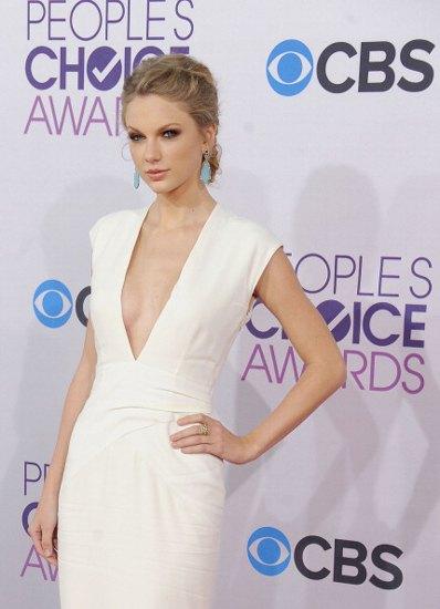 white sleeveless low cut sheath midi dress