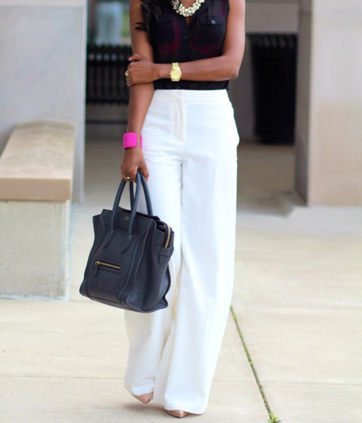 white trousers with black sleeveless blouse and statement necklace