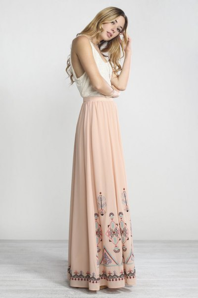 white vest top pale pink floor length bohemian skirt