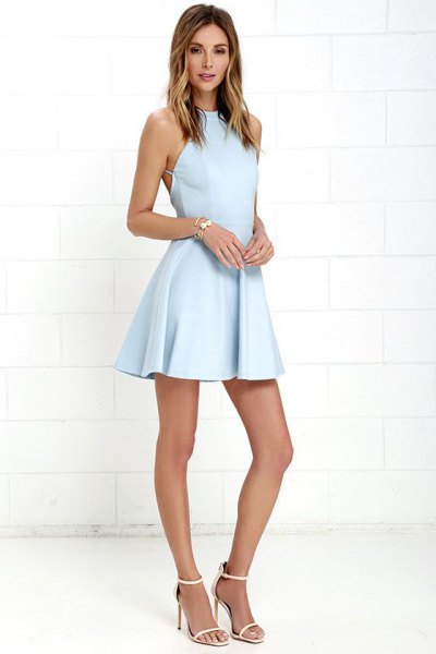 baby blue halter neck fit and flare mini dress with white open toe heels