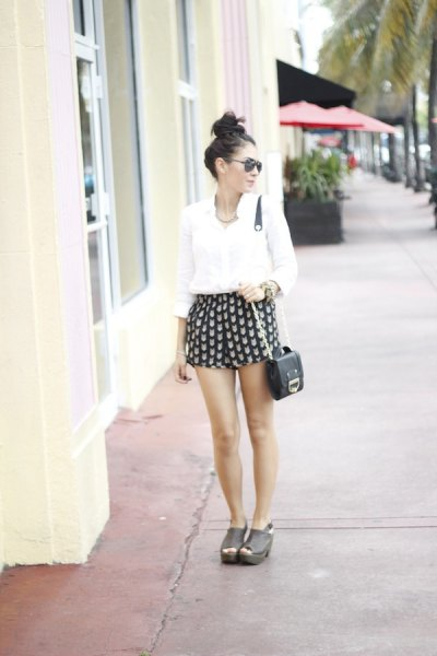black and pink patterned mini shorts with white button up shirt