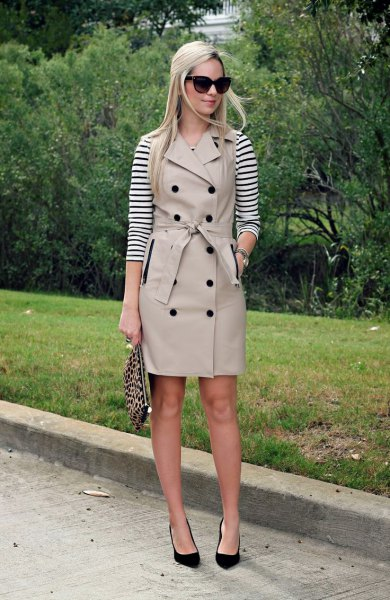 black and white striped long sleeve tee with pale pink belted sleeveless trench coat