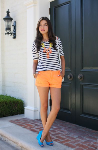 black and white striped tee with orange cuffed shorts