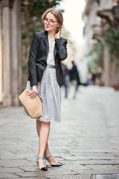 black blazer with grey pleated dress and black ankle strap kitten heel shoes