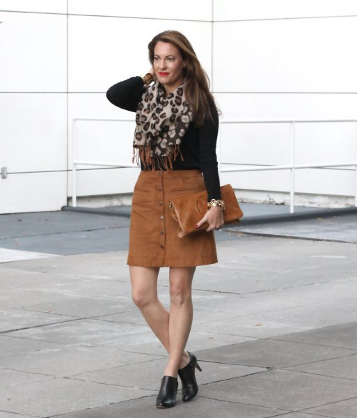 black form fitting knit sweater with brown mini skirt