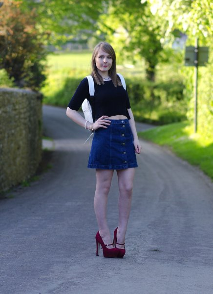 black half sleeve crop top with blue mini flared denim skirt