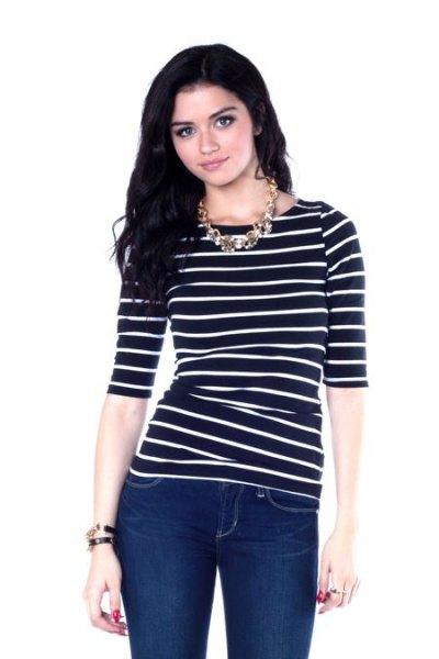 black half sleeve striped boat neck top with dark blue skinny jeans