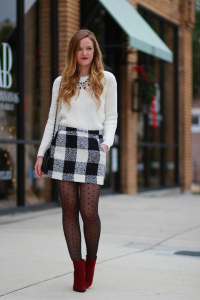 black knit sweater and black patterned stockings