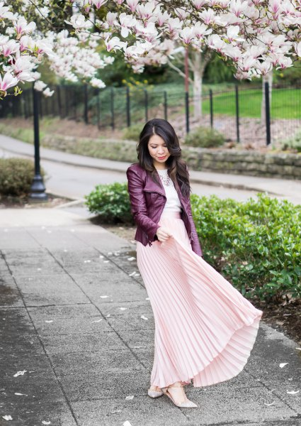 black leather jacket with pale pink maxi pleated skirt