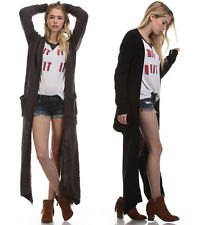 black long cardigan with white print tee and blue denim shorts