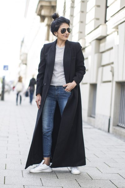 black maxi wool coat with grey sweatshirt and ankle jeans