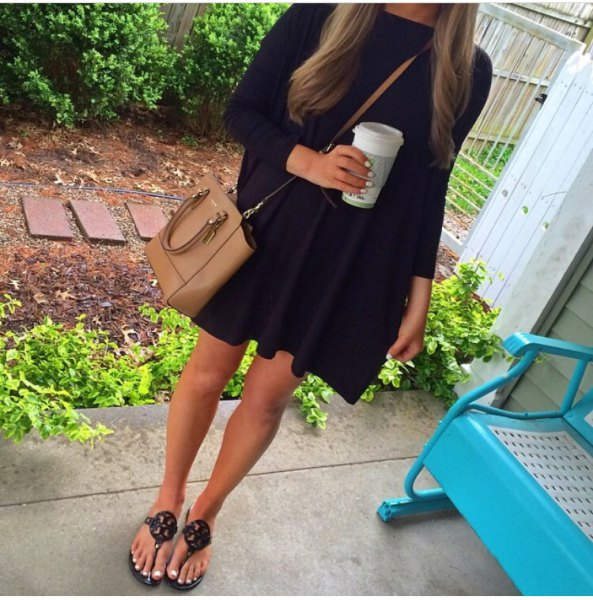 black mini dress with brown leather shoulder bag