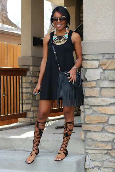 black mini dress with gladiator sandals