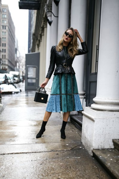 black peplum leather jacket with blue midi flared skirt