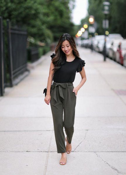 black ruffle tee with green tie waist straight leg ankle pants