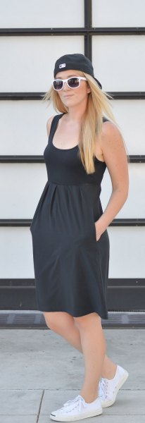 black scoop neck knee length sundress with baseball cap