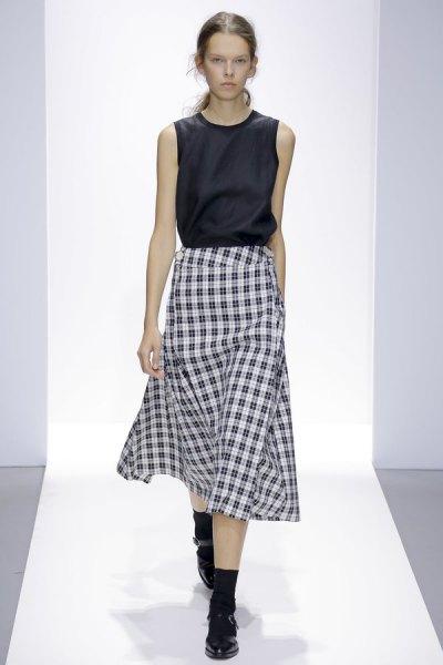 black sleeveless silk top with midi checkered skirt
