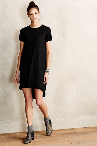 black tunic dress with grey socks and boots