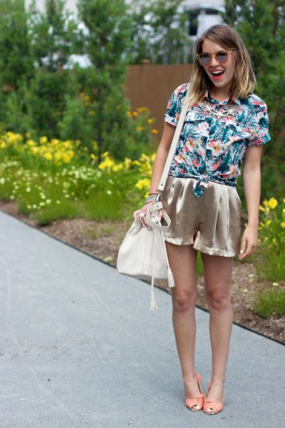 blue and white floral printed shirt with rose gold mini silk shorts