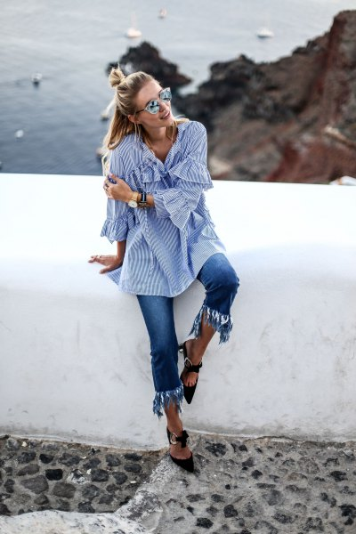 blue and white striped bell sleeve shirt with cropped fringe jeans