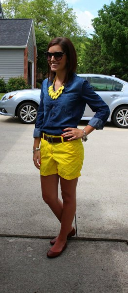 blue chambray button up shirt with yellow shorts