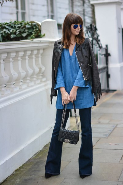 blue v neck tunic with black leather jacket and flared jeans