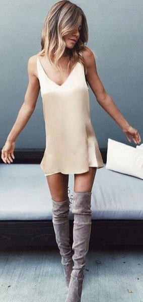 blush pink mini slip dress with grey suede thigh high boots