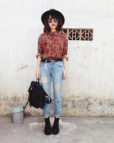 brown printed vintage button up shirt with high waisted ripped jeans