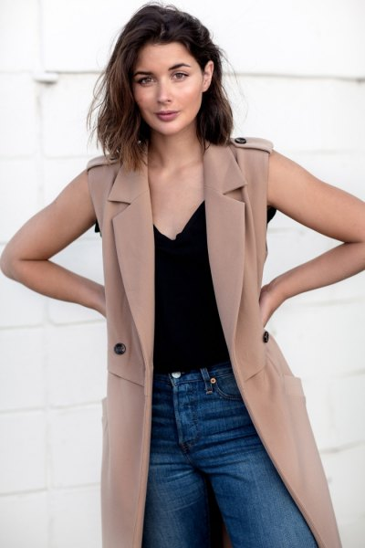 camel sleeveless trench coat with black camisole and jeans