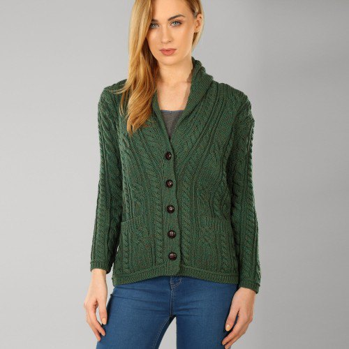 dark green cable knit sweater with unwashed blue skinny jeans