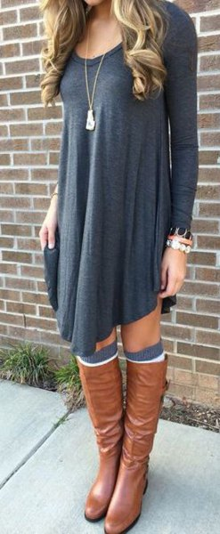 dark grey long sleeve swing dress with brown leather boots