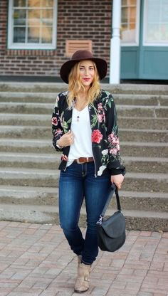 floral bomber jacket with white vest top and black felt hat