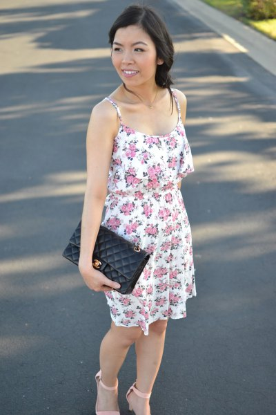floral mini sundress with black leather clutch bag