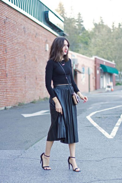 form fitting cropped knit sweater with black midi pleated skirt