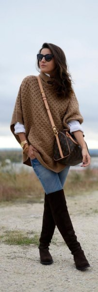 green cable knit poncho sweater with black thigh high boots