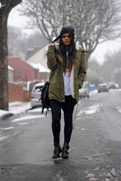 green fur lined parka coat with white print tee and black mini shorts