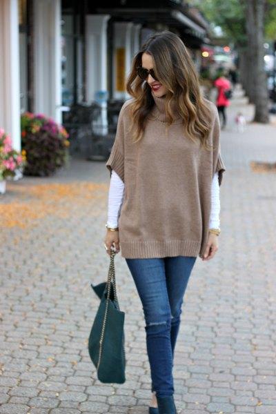 green half sleeve sweater over white long sleeve tee