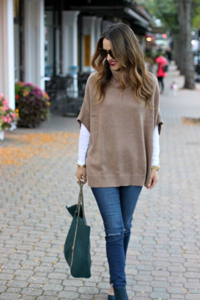 green half sleeve sweater over white long sleeve tee