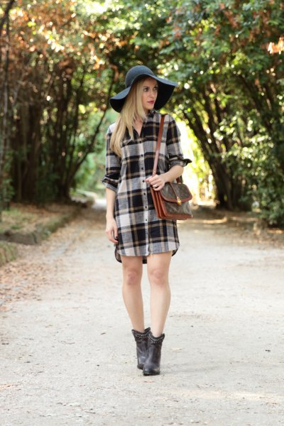grey and white plaid flannel shirt dress with black floppy hat