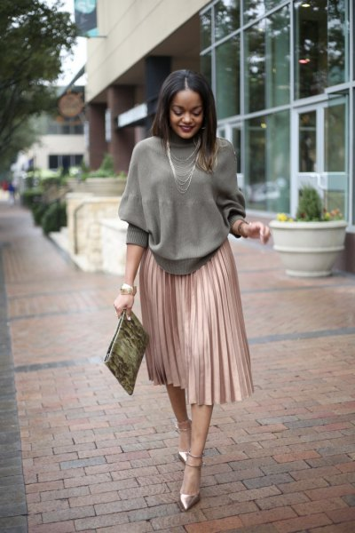 grey crew neck knit sweater with rose gold pleated skirt