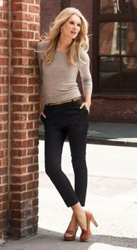 grey form fitting long sleeve tee with black skinny pants