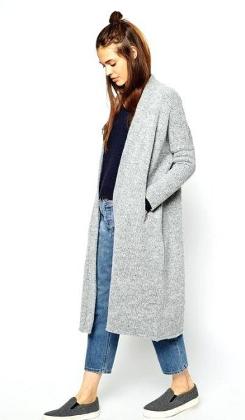 grey long cardigan with black sweater and blue ankle jeans