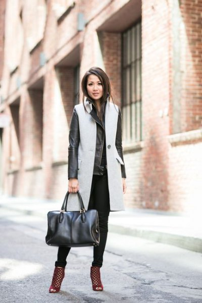grey long wool sleeveless coat with black leather jacket